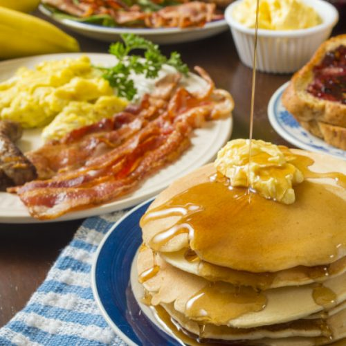 Pancakes, eggs, bacon, sausage, coffee, tea
